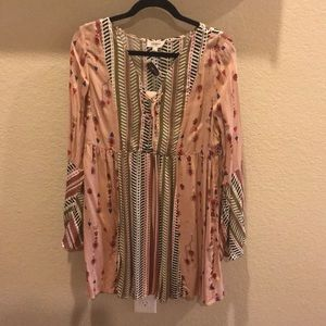 Cute top with lace up front and bell sleeves